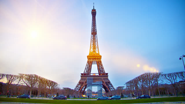 the classical view of eiffel tower in paris. tourism. international landmark. sun flare. sunny. sunset. - eiffel tower paris stock videos & royalty-free footage