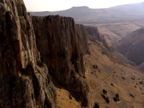 the cliffs of mount arbel rise above caesarea and the sea of galilee. - caesarea stock videos & royalty-free footage