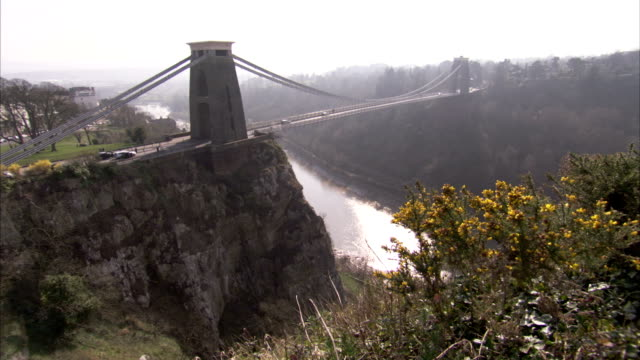 the clifton suspension bridge carries traffic across the avon gorge in bristol, england. available in hd. - clifton suspension bridge stock videos and b-roll footage