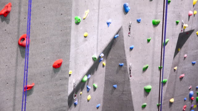 the climbing wall is an artificially constructed wall with grips for hands and feetthe complex will host the swimming diving other competitions in... - climbing wall stock videos & royalty-free footage