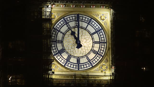 the clock face of elizabeth tower, commonly known as big ben, is seen at the stroke of 11pm on december 31, 2020 in london, england. at 11pm gmt this... - big ben stock videos & royalty-free footage