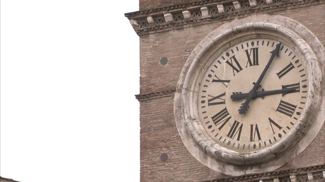 The clock on a tower shows that one minute has passed.