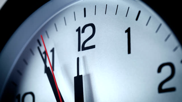 the clock strikes 12 - midday stock videos & royalty-free footage