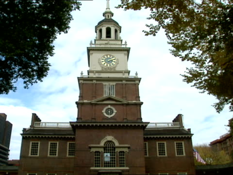 the clock tower of independence hall in philadelphia is an historic landmark - independence hall stock videos and b-roll footage