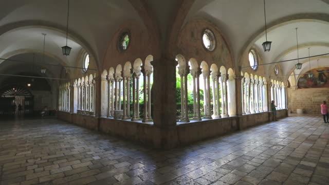 the cloisters of the franciscan monastary, dubrovnik city, dalmatia coast, croatia. - monastero video stock e b–roll