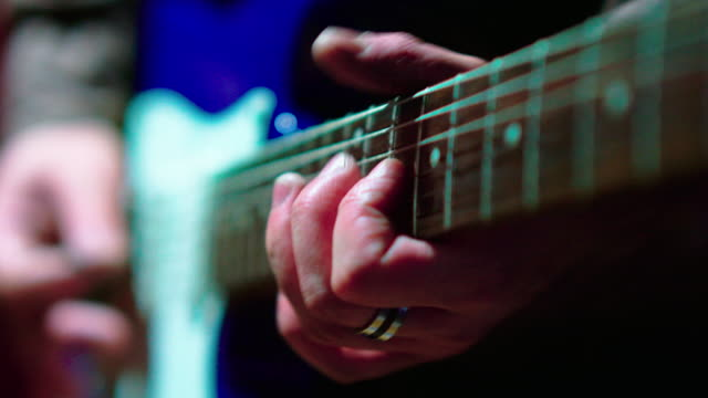 the closeup video of the man playing guitar - guitarist stock videos & royalty-free footage
