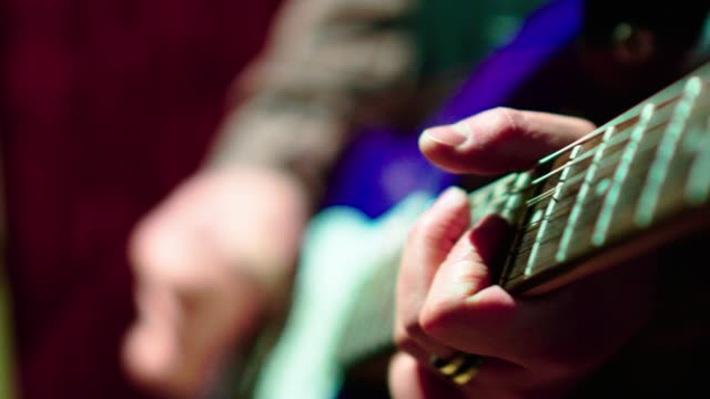 the closeup video of the man playing guitar - live event stock videos & royalty-free footage