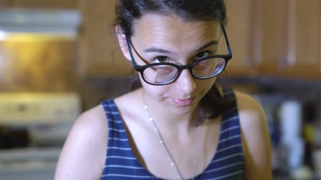the closeup video portrait of the busy teenage girl wearing big eyeglasses - video portrait stock videos & royalty-free footage