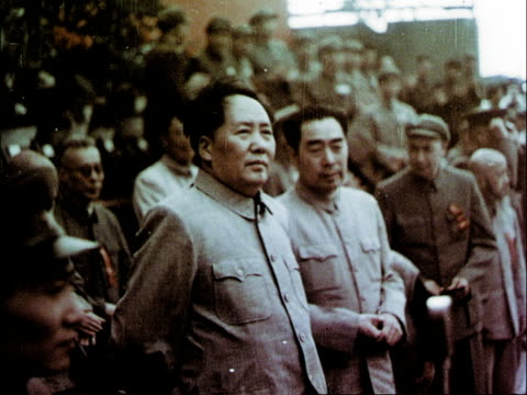 The closing ceremony for the games / band plays and Chairman Mao arrives to applause