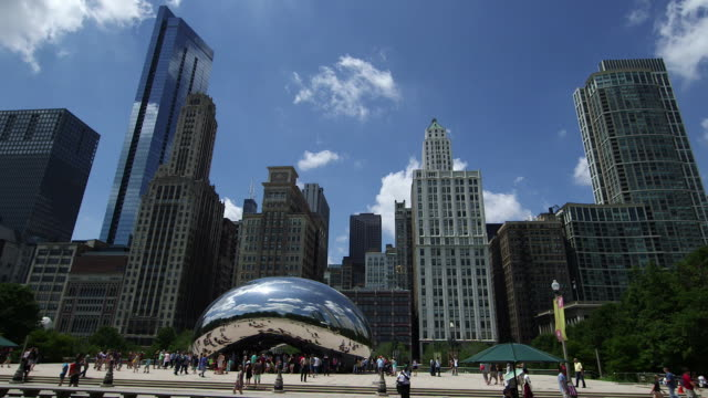 "the cloud gate sculpture (aka ""the bean sculpture"") in millenium park, chicago - bean stock videos and b-roll footage"