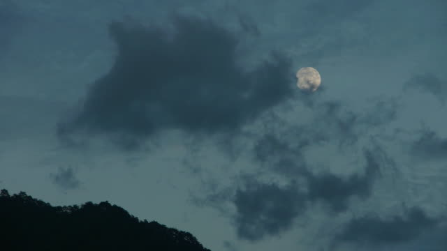 the clouds are flowing and the moon is disappearing - full moon stock videos & royalty-free footage