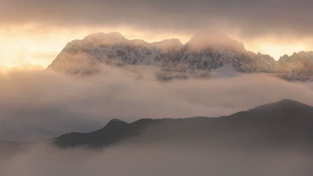 the clouds spread a crack and saw the dreamy mountains at sunrise - distant stock videos & royalty-free footage
