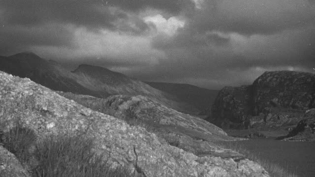 1944 montage the cloudy sky and rolling hills of the scottish highlands / achriesgill, scotland, united kingdom - achriesgill stock videos & royalty-free footage