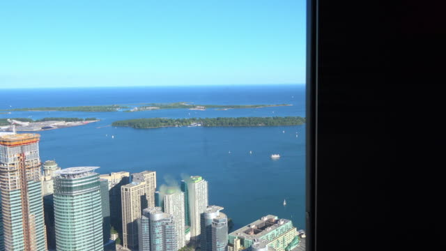 the cn tower elevator, point of view of the city skyline and lake ontario - elevator point of view stock videos and b-roll footage