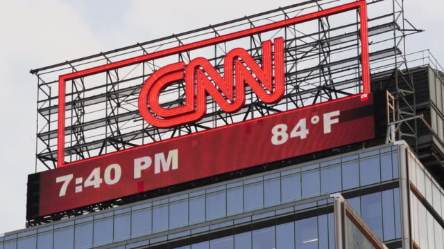 the cnn billboard in columbus circle with time and temperature.  clock changes - cnn stock videos & royalty-free footage