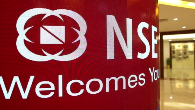 The CNX Nifty Index and the National Stock Exchange of India Ltd logo is displayed on a large screen in the atrium of the National Stock Exchange of...