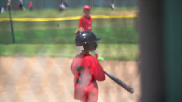 the coach gives a high-five to a boy playing little league baseball. - slow motion - number 5 stock videos & royalty-free footage