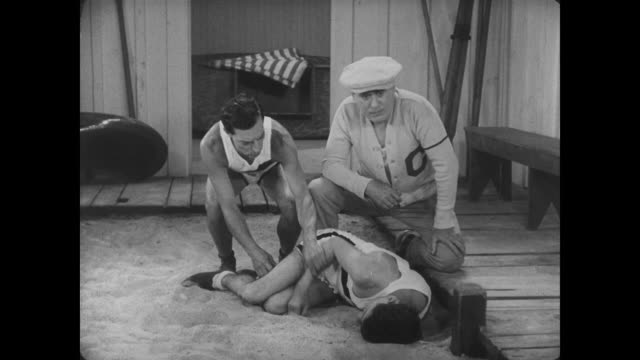 1927 the coach is surprised when man (buster keaton) drags his sleeping teammate out of the locker room - boxing heavyweight stock videos & royalty-free footage