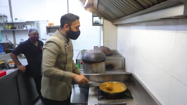 the coal-fired tandoor oven sends a mouth-watering scent wafting through the mumbai kitchen as celebrity chef saransh goila, maker of the world's... - masterchef stock videos & royalty-free footage