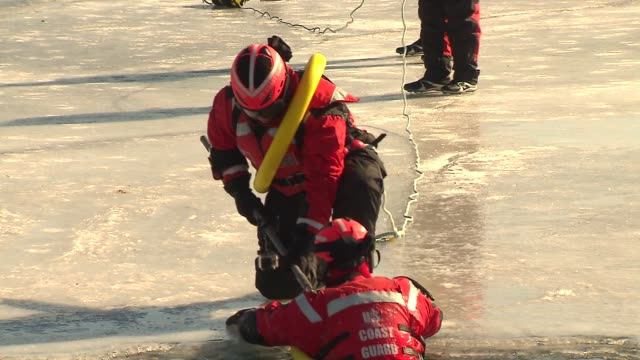 the coast guard demonstrated how they train for rescues on the icy water of lake michigan on february 27, 2014 in chicago, illinois. - practice drill stock videos & royalty-free footage