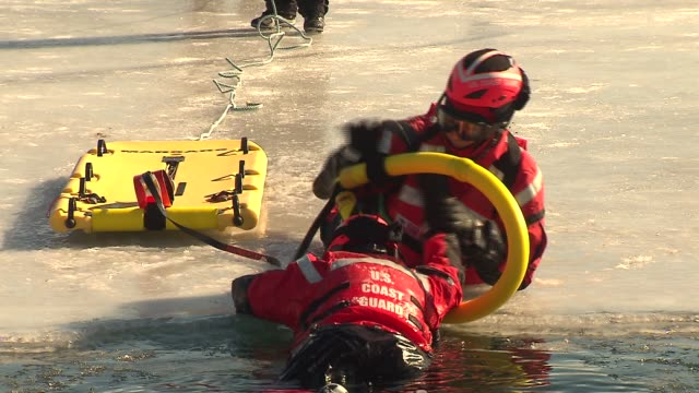 wgn the coast guard demonstrated how they train for rescues on the icy water of lake michigan on february 27 2014 in chicago illinois - befreiung stock-videos und b-roll-filmmaterial