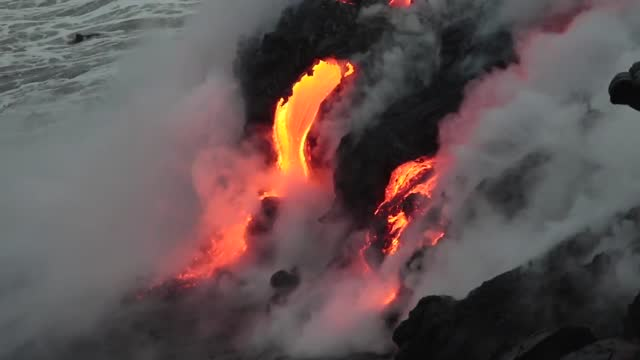 the coast guard in hawaii has enforced http://bigislandnow.com//usgs-kamokuna-delta-collapse-likely/ a temporary safety zone around the kamokuna lava... - fear stock videos & royalty-free footage