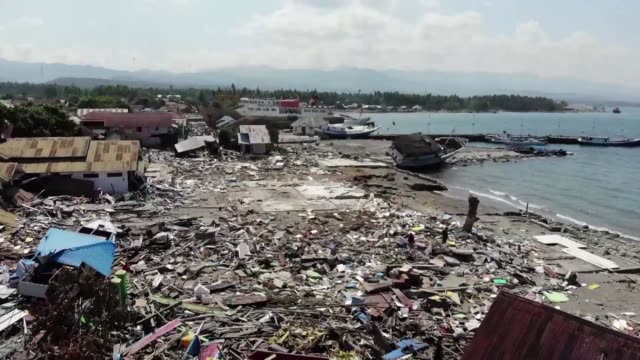 the coastal area around palu on the indonesian island of sulawesi is badly damaged after a tsunami hit the area on friday - tsunami stock videos & royalty-free footage
