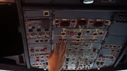 The cockpit of the aircraft. The pilot checks the electronics of the aircraft. Preparation of a passenger airliner for takeoff. The pilot checks the plane for flight. 4k
