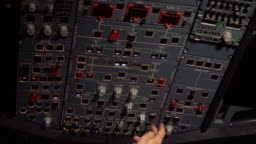 The cockpit of the aircraft. The pilot checks the electronics of the aircraft.
