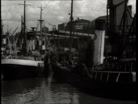 hull trawlers in harbour / fisherman with tackle - hull stock videos & royalty-free footage