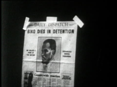 the coffin of civil rights activist steven biko lies on a wooden cart pulled by oxen after he dies while in detention in pretoria south africa - racism stock videos and b-roll footage