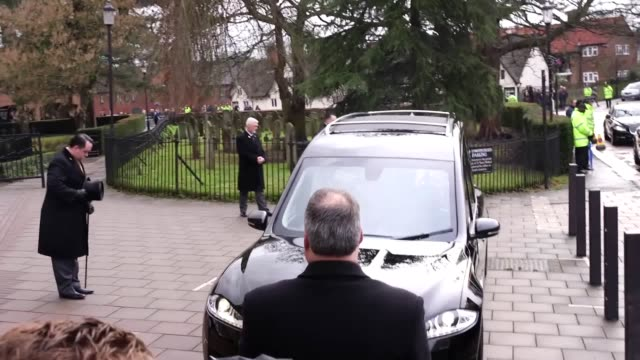The coffin of former England manager Graham Taylor is carried into St Mary's Church Watford
