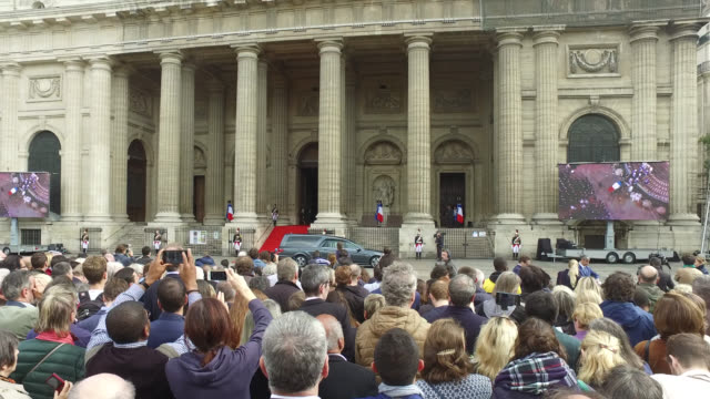 the coffin of former french president jacques chirac, covered with the french national flag, is carried by pall bearers as it leaves the... - large scale screen stock videos & royalty-free footage