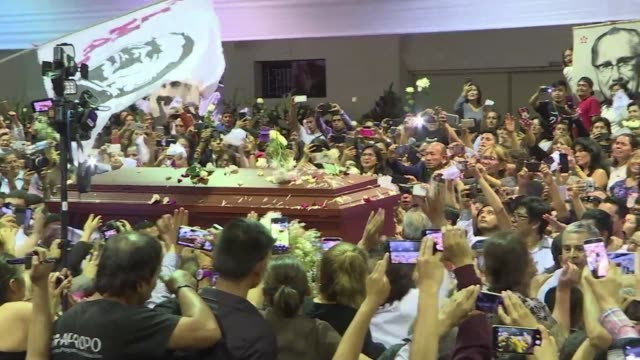 stockvideo's en b-roll-footage met the coffin of late peruvian former president alan garcia arrives at the american popular revolutionary alliance party headquarters in lima where... - former