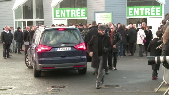 the coffin of stephane charbonnier charb cartoonist and editor of charlie hebdo was greeted with applause on friday - cartoonist stock videos & royalty-free footage