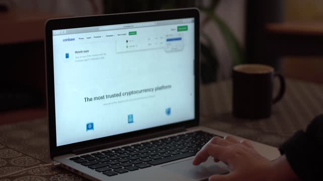the coinbase, cryptocurrency, website is seen on a laptop computer - blockchain stock videos & royalty-free footage
