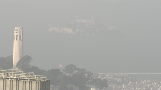 the coit tower and alcatraz island surrounded in dense smoke from nearby wildfires on november 17, 2018 in san francisco, ca. - coit tower stock videos & royalty-free footage