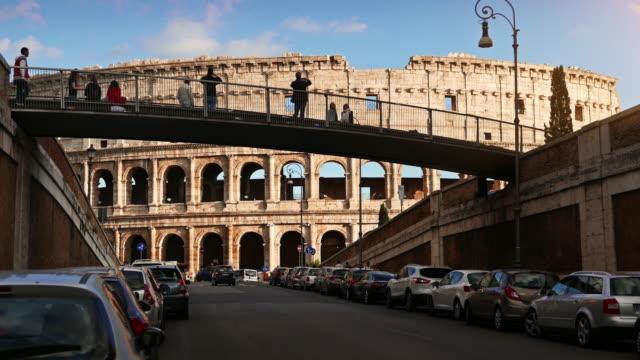 the coliseum of rome and annibaldi bridge - colosseo video stock e b–roll