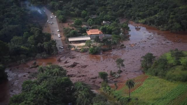 the collapse of a disused dam owned by brazilian mining giant vale in brazil releases a massive torrent of mud that washed over the iron ore... - collapsing stock videos and b-roll footage