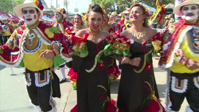 the colombian city of barranquilla celebrates its annual carnival with colourful dances songs and music clean revellers parade during the... - colombia stock videos & royalty-free footage