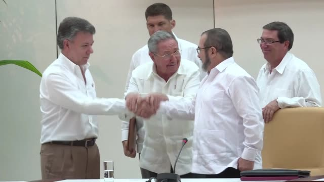 the colombian government and farc rebels will sign a definitive peace deal within six months to end their half century conflict, president juan... - juan manuel santos stock videos & royalty-free footage