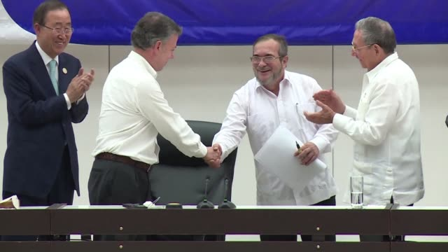 the colombian government and the farc rebel force signed a ceasefire and disarmament agreement thursday one of the last steps toward ending a... - disarmament stock videos and b-roll footage