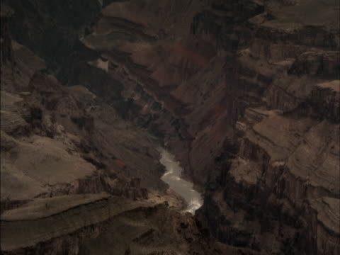 the colorado river flows through the bottom of the grand canyon. - grand canyon stock videos and b-roll footage