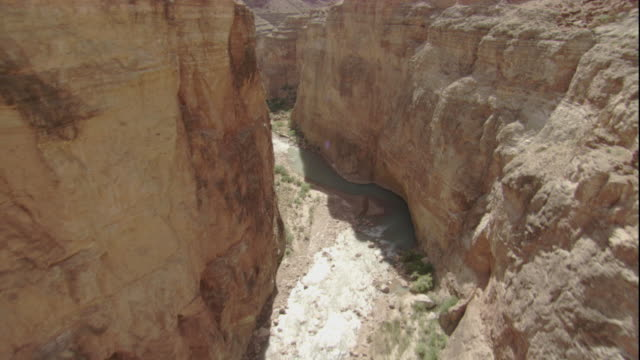 The Colorado River winds along the base of the Grand Canyon. Available in HD.