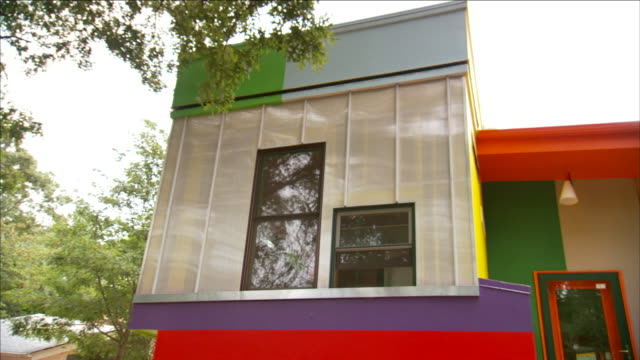 the colorful cellophane walls of a futuristic house provide electricity and light. - cellophane stock videos & royalty-free footage