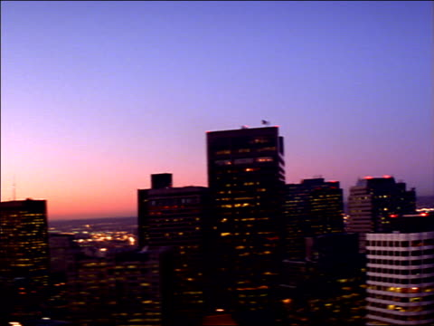 the colorful sky silhouettes downtown boston skyscrapers. - custom house tower stock videos & royalty-free footage