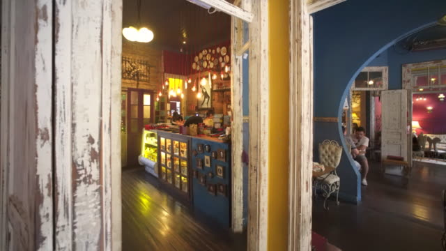 the colourful interior of the agridoce café, porto alegre, southern brazil. - alegre stock videos & royalty-free footage