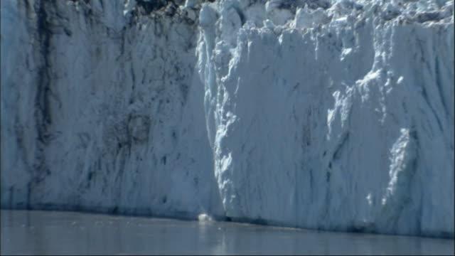 the columbia glacier calves in alaska. available in hd. - columbia glacier stock videos & royalty-free footage