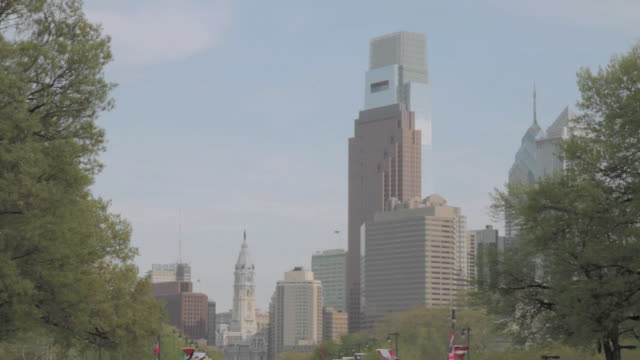 la the comcast center skyscraper towering over the city skyline / philadelphia, pennsylvania, united states - center city philadelphia stock videos and b-roll footage