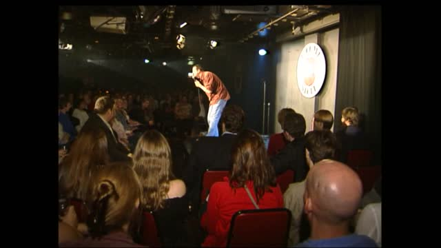 the comedy store general views; england: london: soho: the comedy store: int gv 'the comedy store' sign in club to audience applauding to lms side... - southern california stock videos & royalty-free footage